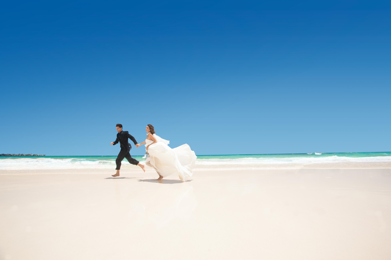 Beach wedding at Sandals Resorts